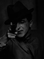 Jean Cocteau with Gun  (1926), gelatin silver print (Berenice Abbott Archive, Ryerson Image Centre © Ronald Kurtz, administered by Commerce Graphics Ltd. Inc.)