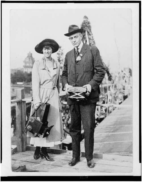 Lucian and Helen Johns Kirtland , full-length portrait, facing front, both holding cameras. Between 1910 and 1920.