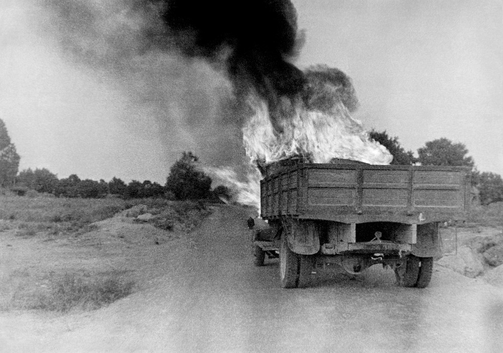 Burning truck, Battle of Brunete.  July 1937. Brunete, Spain.