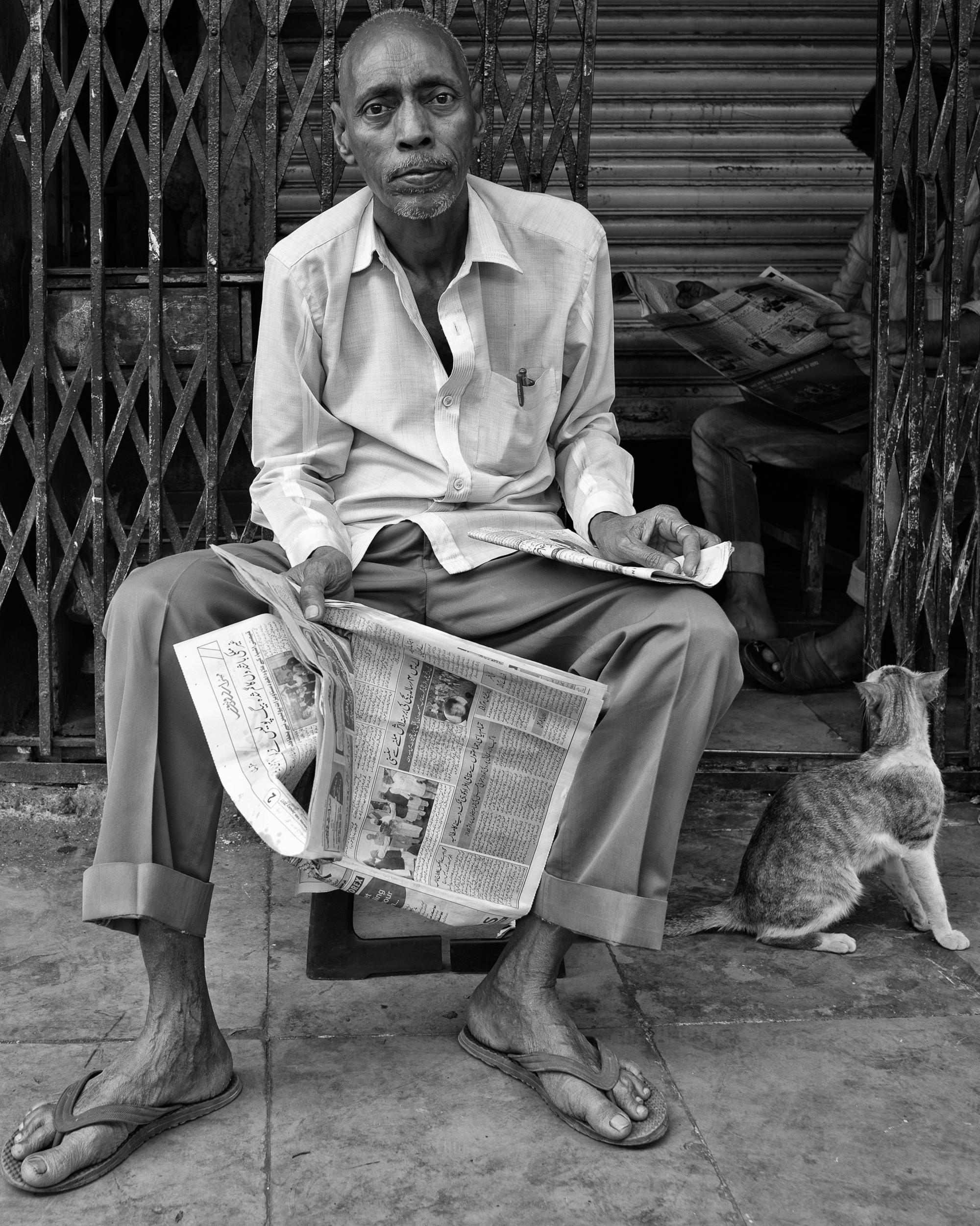 gentleman with his paper, mumbai