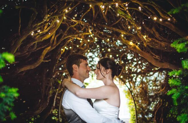 Bride_groom_fairylights_glemhamhall.jpg