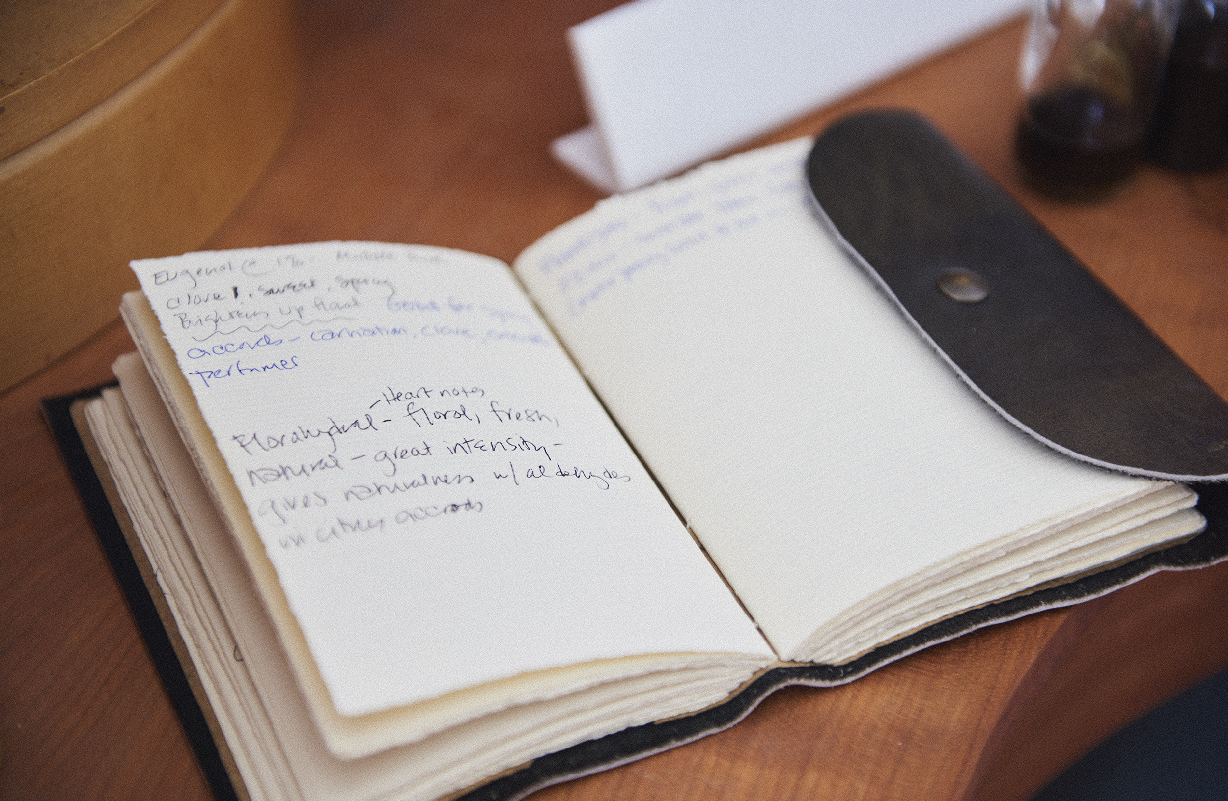 Copy of Notebook on desk with perfume notes