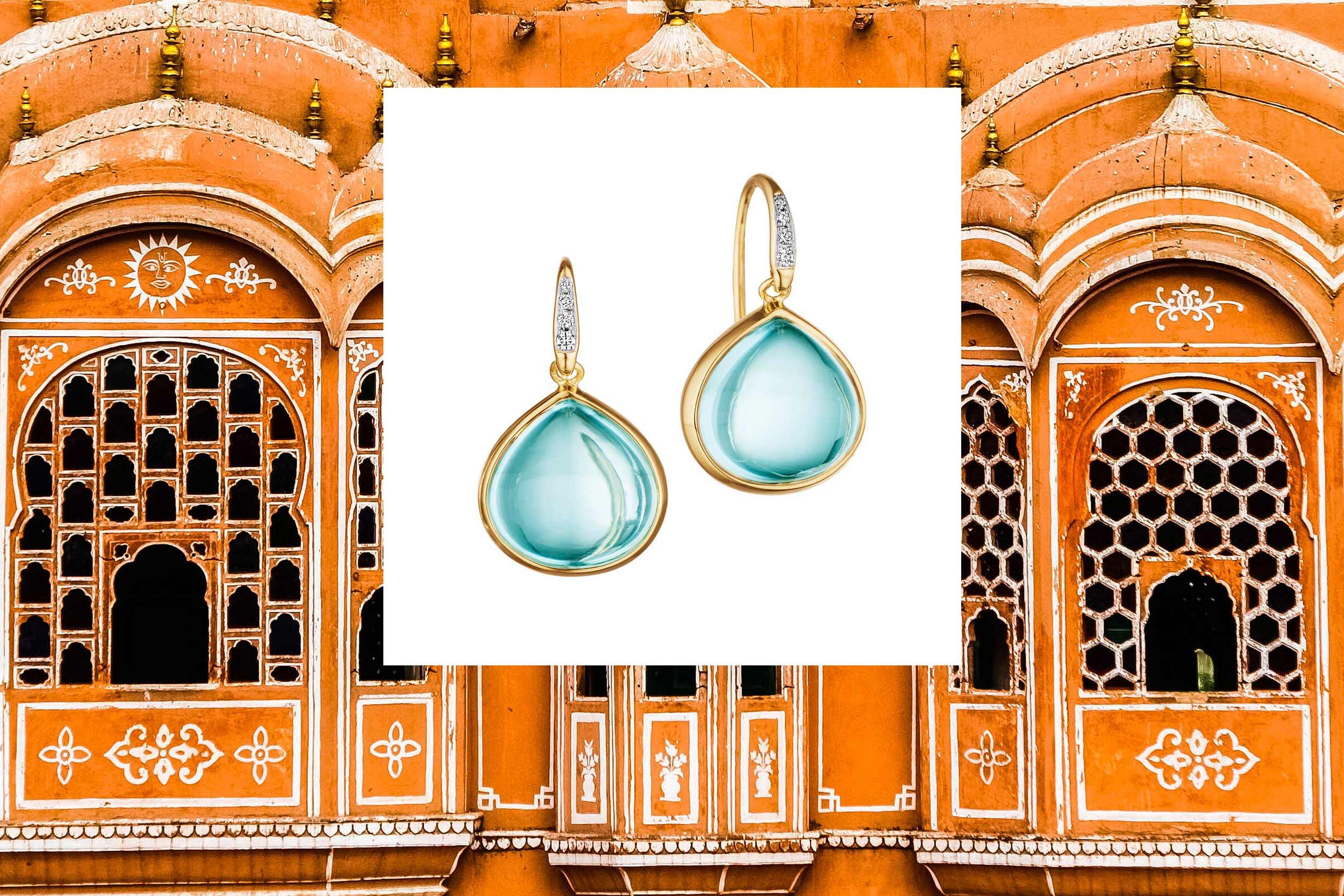 18kyg blue topaz mogul earrings with diamonds