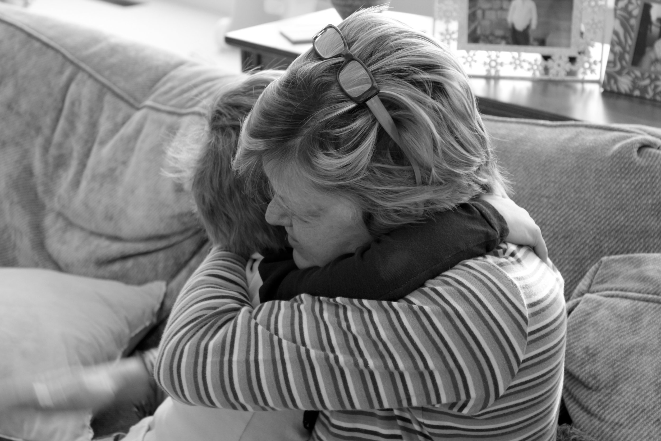 Home from the hospital, Barb Brown hugs her grandchild.