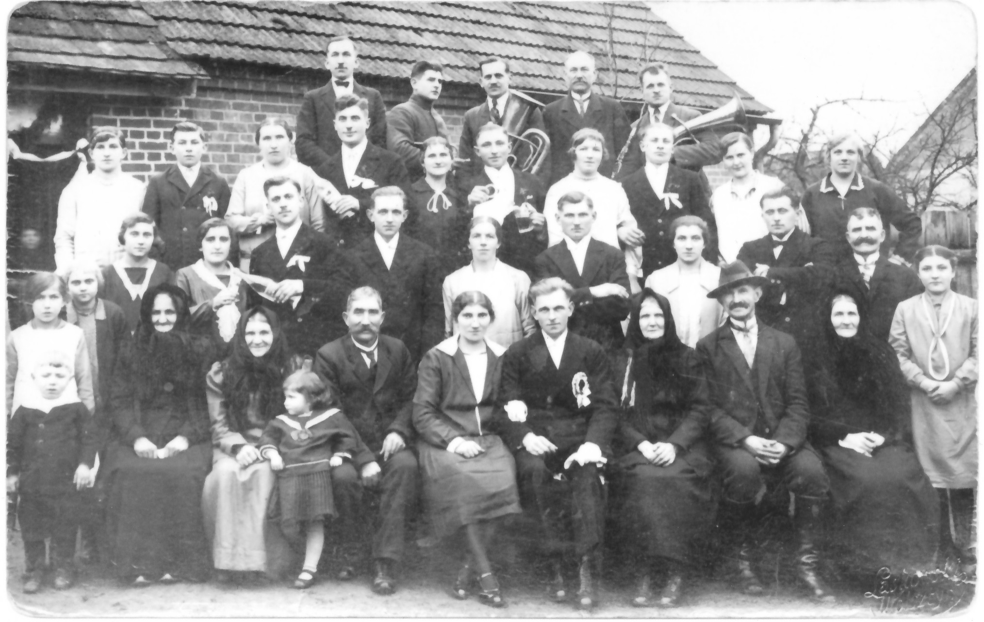 Photo taken in 1929 at a Utrajczak family wedding. In the front row left to right: Helen's sister Anna (wearing white dress), grandmother, mother, father, sister Maria (the bride), the groom, the groom's parents, the groom's grandmother, and Helen.