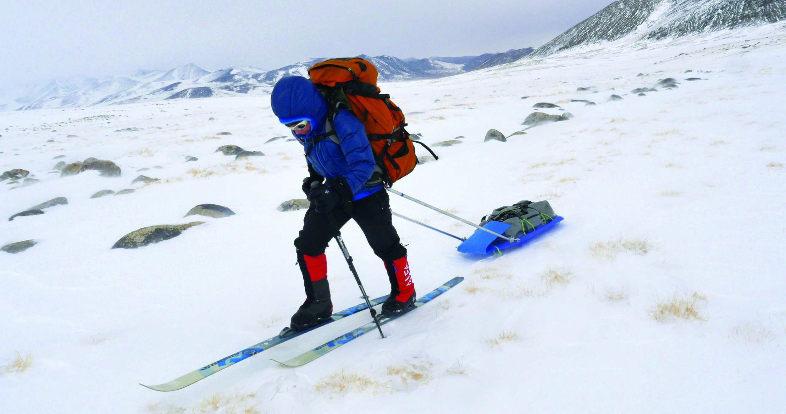 Alison Criscitiello muscles across the Pamir Plateau during the Borderski expedition.