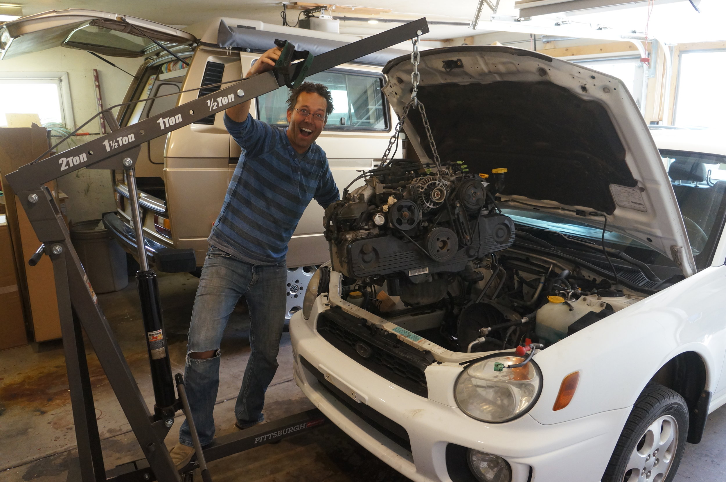 """April 2017 - Chip, a.k.a. """"The Mad Scientist,"""" pulling out the Impreza engine so Spud can soon keep up with other cars on the road. Don't let him anywhere near your Subaru. Note the headlamp-induced hair style which is vaguely reminiscent of the sweet bowl-cut he sported in high school. Try not to be jealous."""