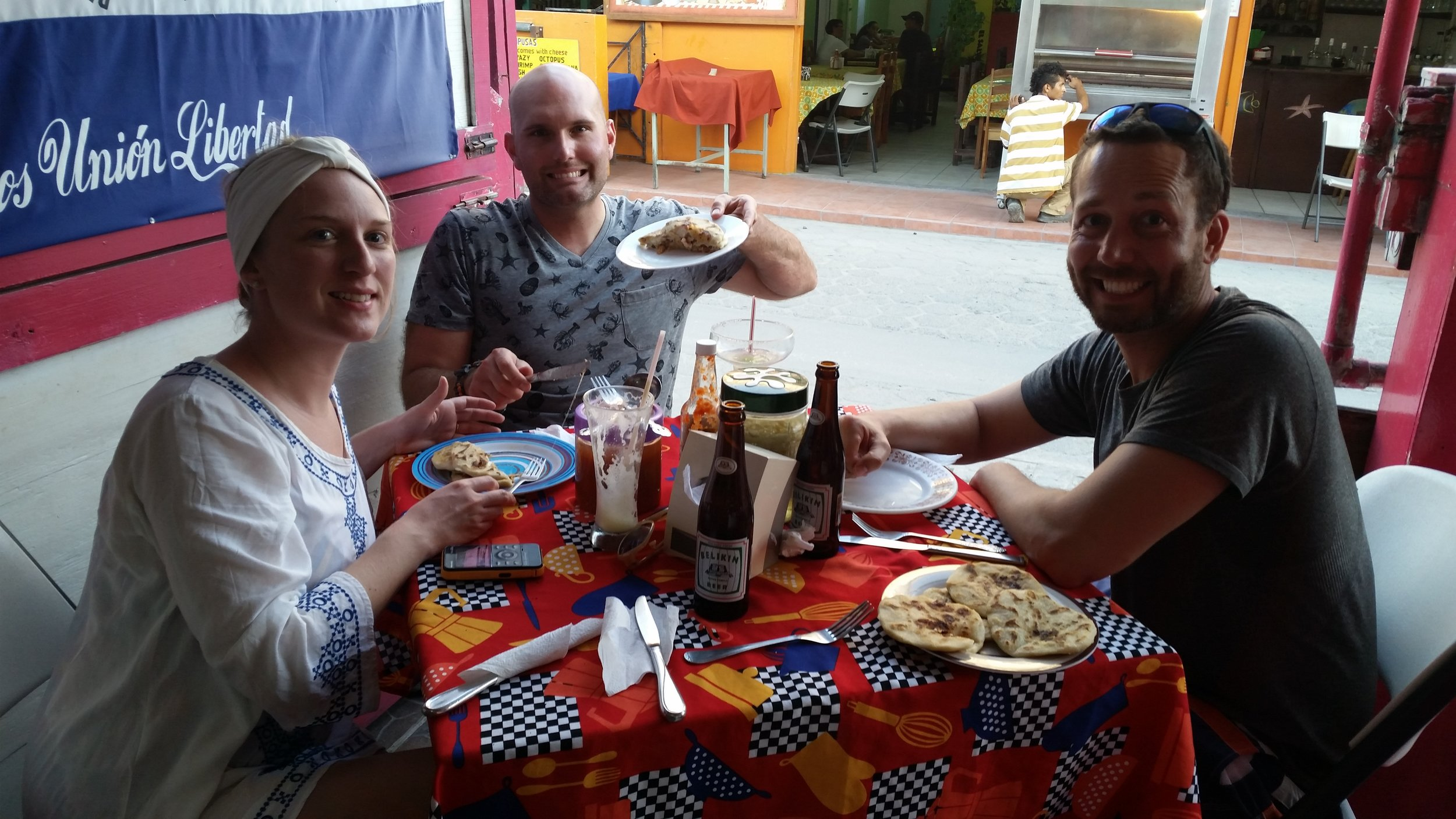 Pupusas and Beliken beer = Four happy tourists