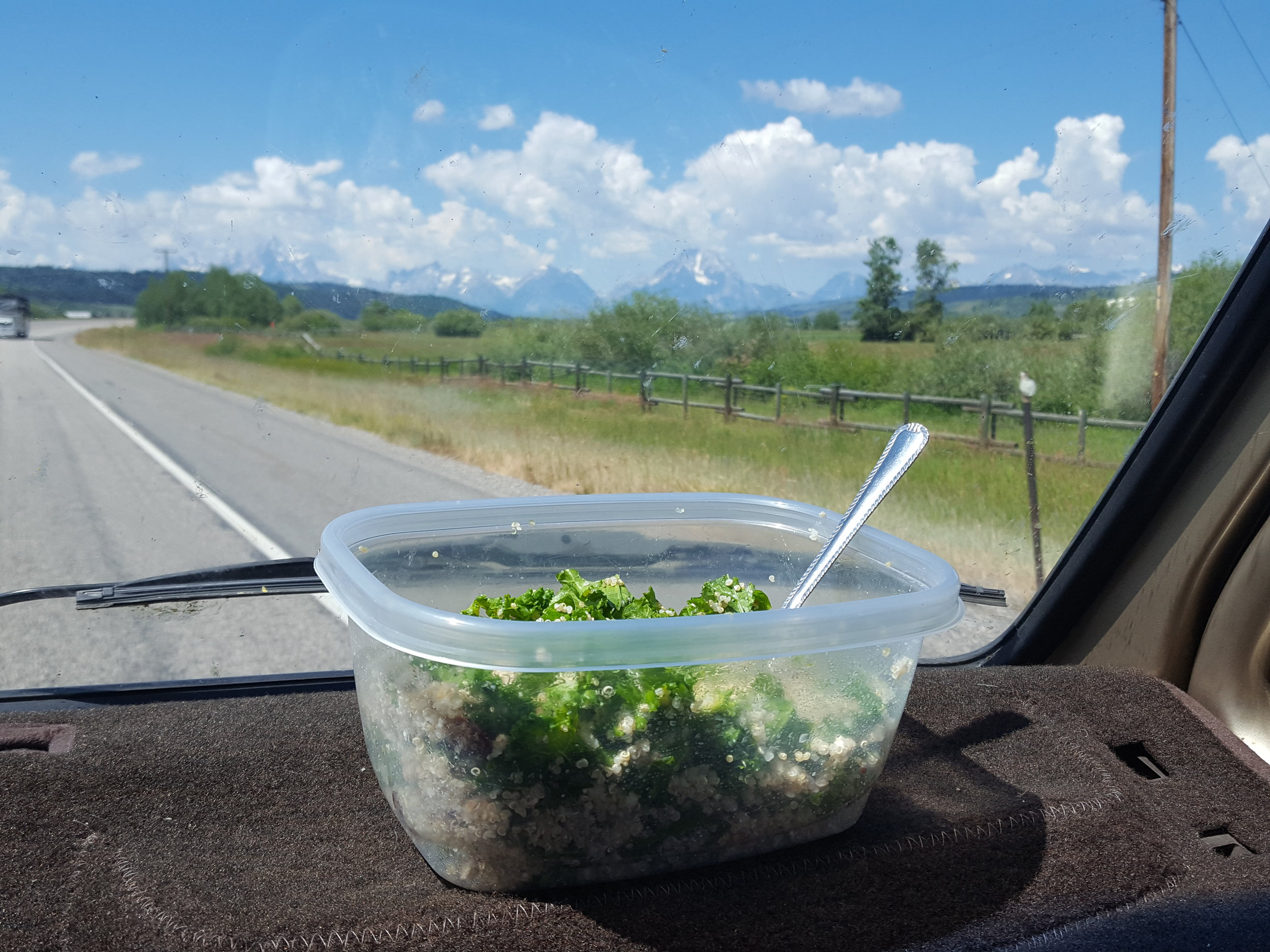 My lunch (queen-o 'n kale)with mountain views in the distance. Lest you think I've gone crunchy, dinner the previous night consisted of ramen and cheetos