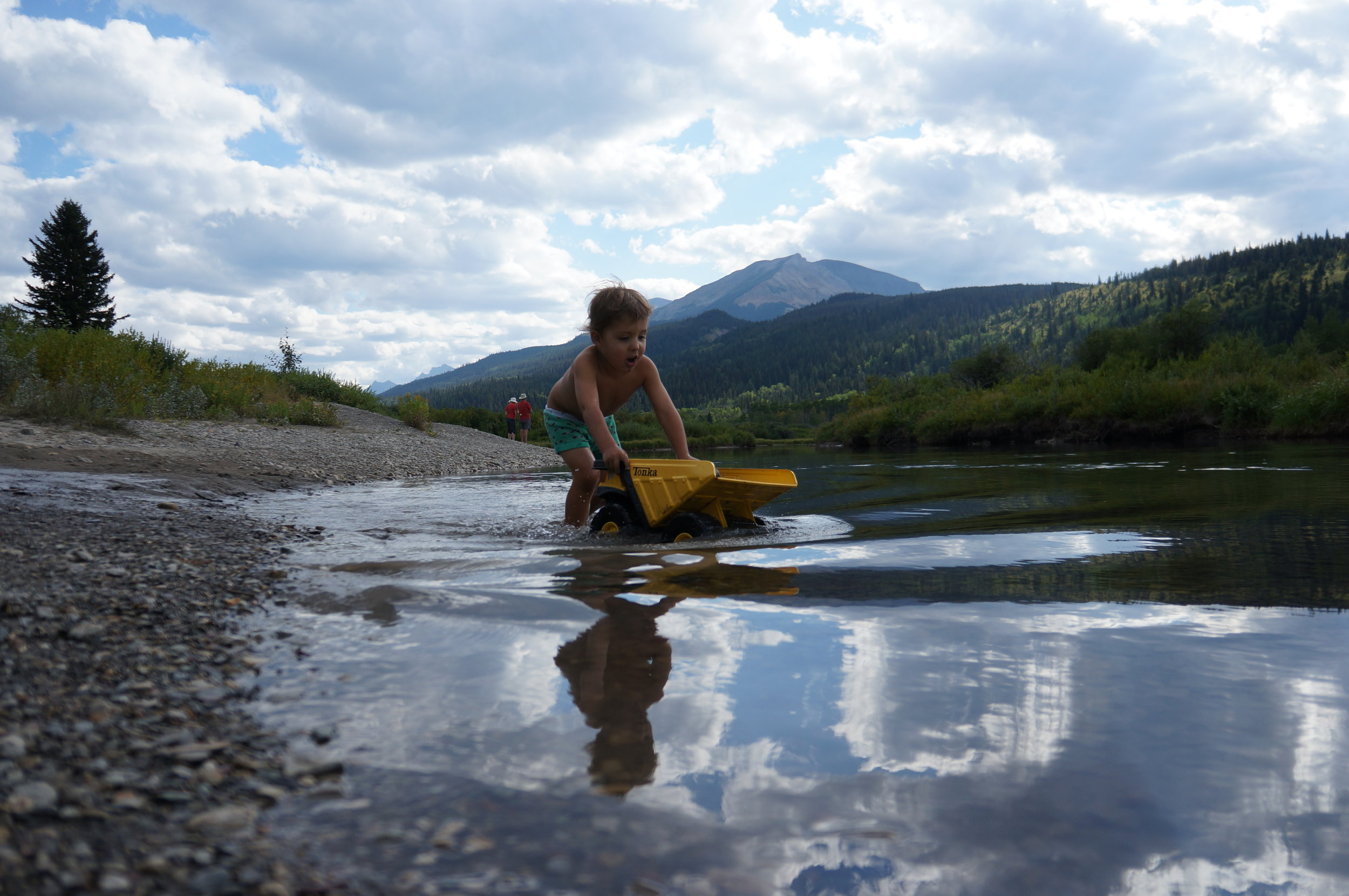 Reid mastered the skill of pushing dump trucks through a river in his underwear (But can you see him blabbing away?!)