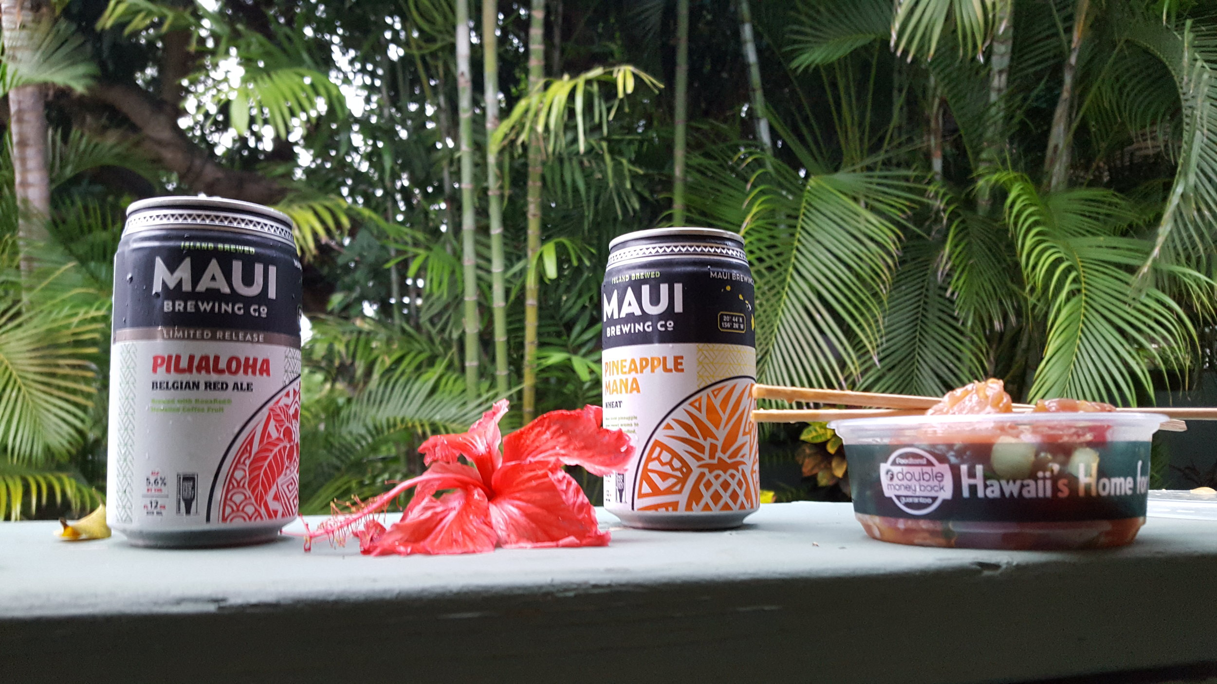 Three essentials: Beer, Poke, and a green, tropical backdrop.