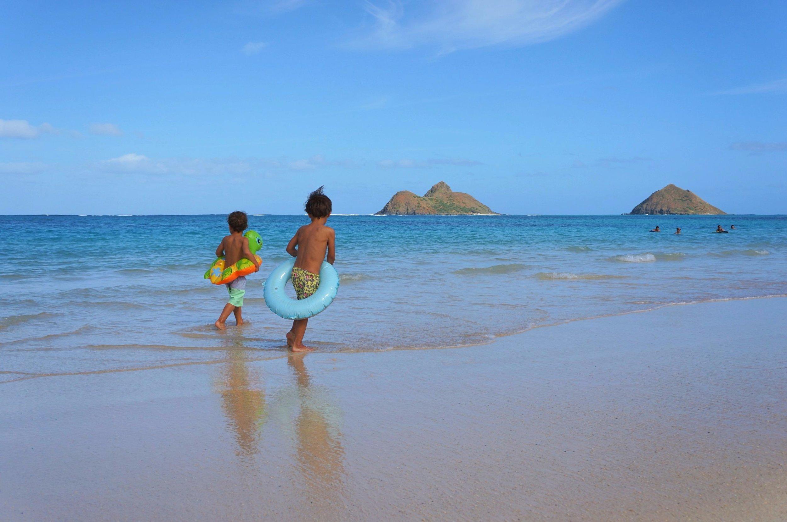 The boys preparing for a swim on Lanikai Beach.