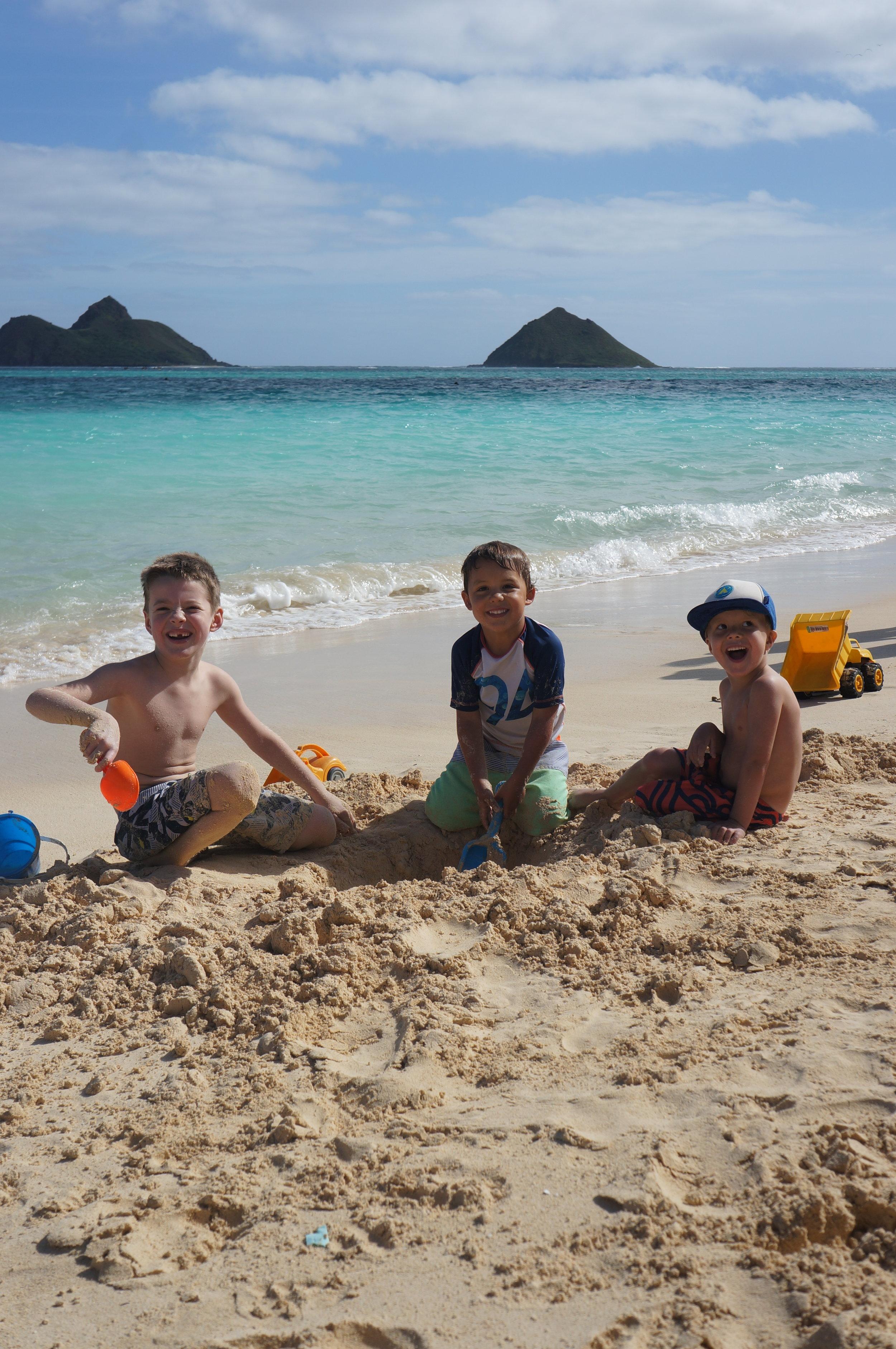A couple of old pals just hanging out on Lanikai Beach. Sam, Reid, & Owen Butzen.