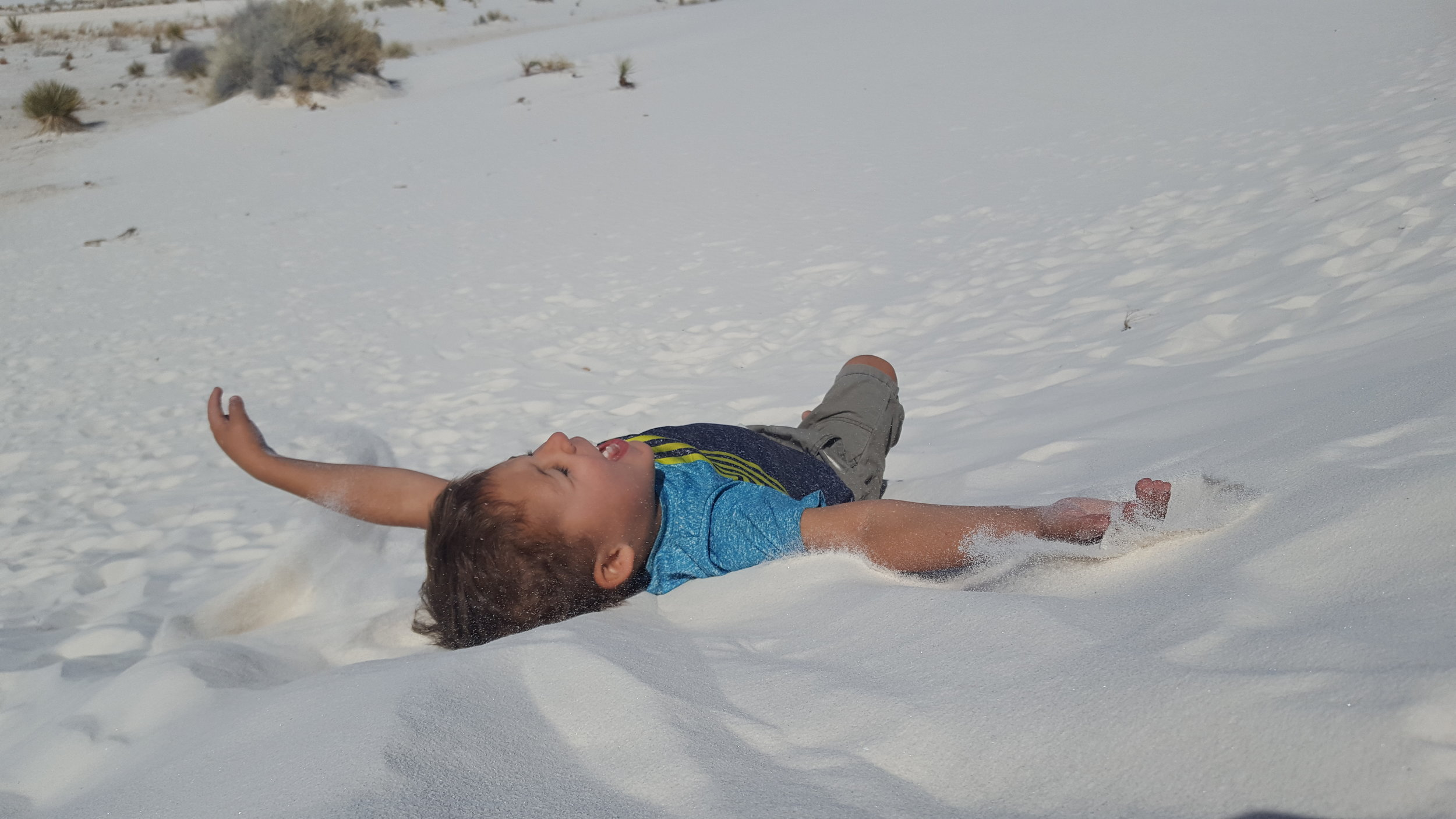 Rolling in the sand and getting it in every crevice of your body is totally acceptable.