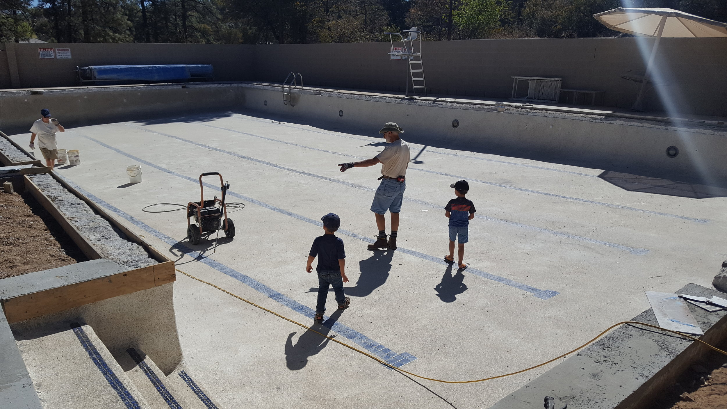 The boys supervising the pool efforts.