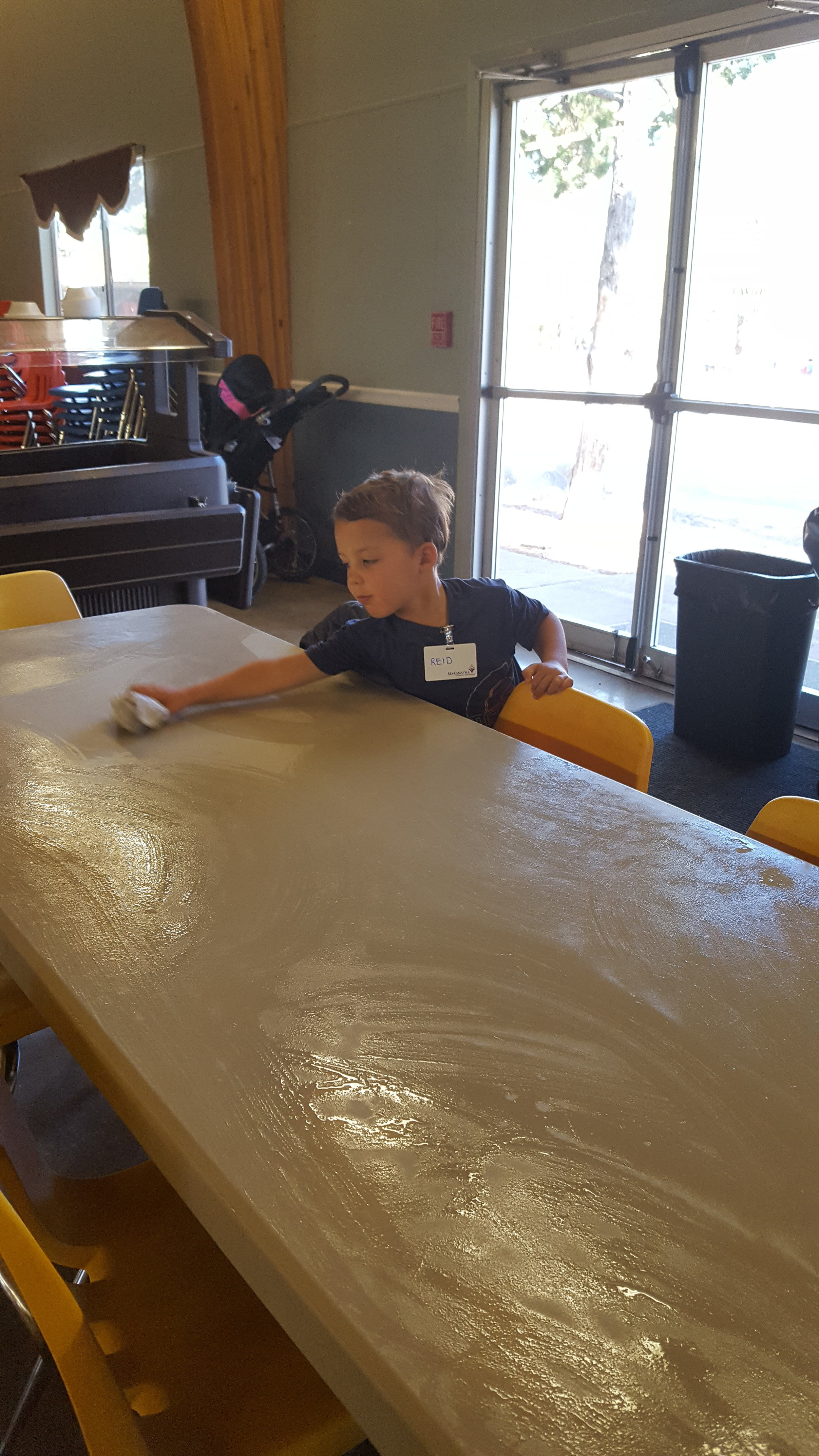 The boys were in charge of cleaning all the tables after breakfast, lunch, and dinner.