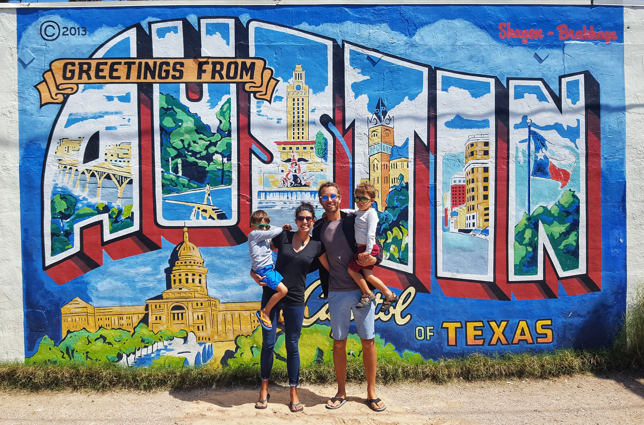 Being tourists at the Greetings From Austin mural!