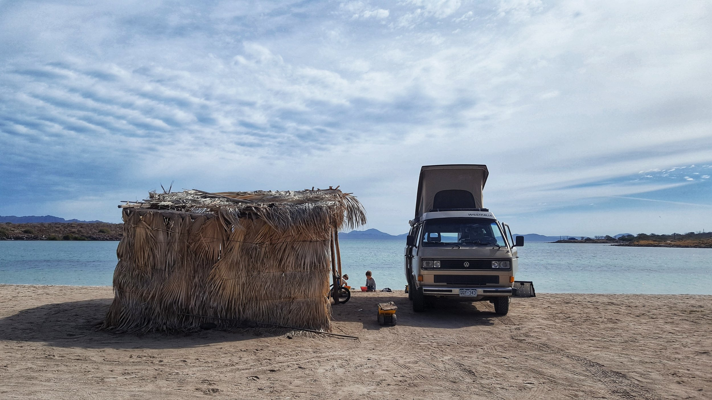 Often in Baja, campers can count on enjoying a palapa (or palm leaf structure) alongside their camper. Great for shade, storage, and extra outdoor space!