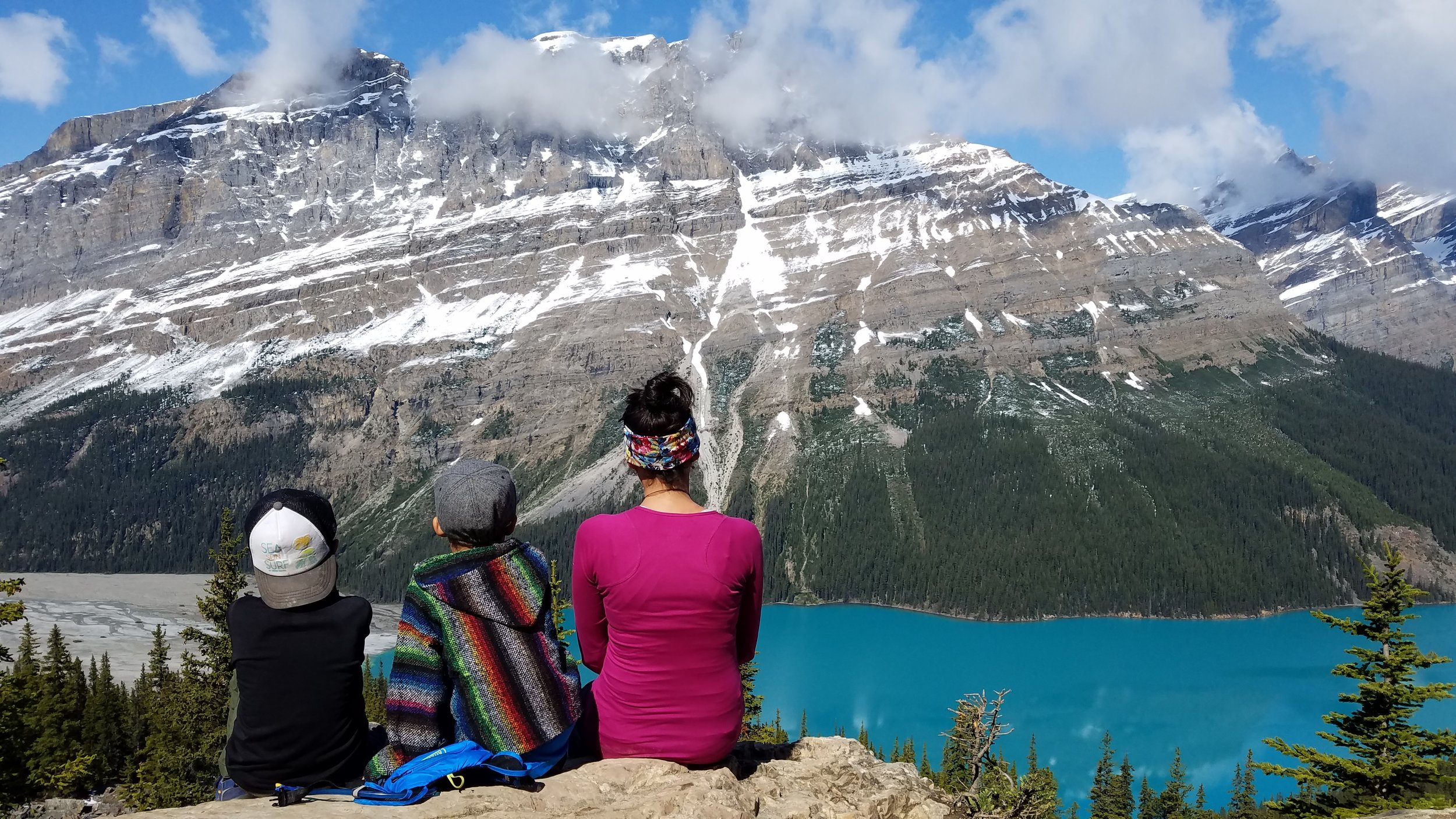 Snacking, staring, and probably crying (me!) while enjoying the views of Peyto Lake.