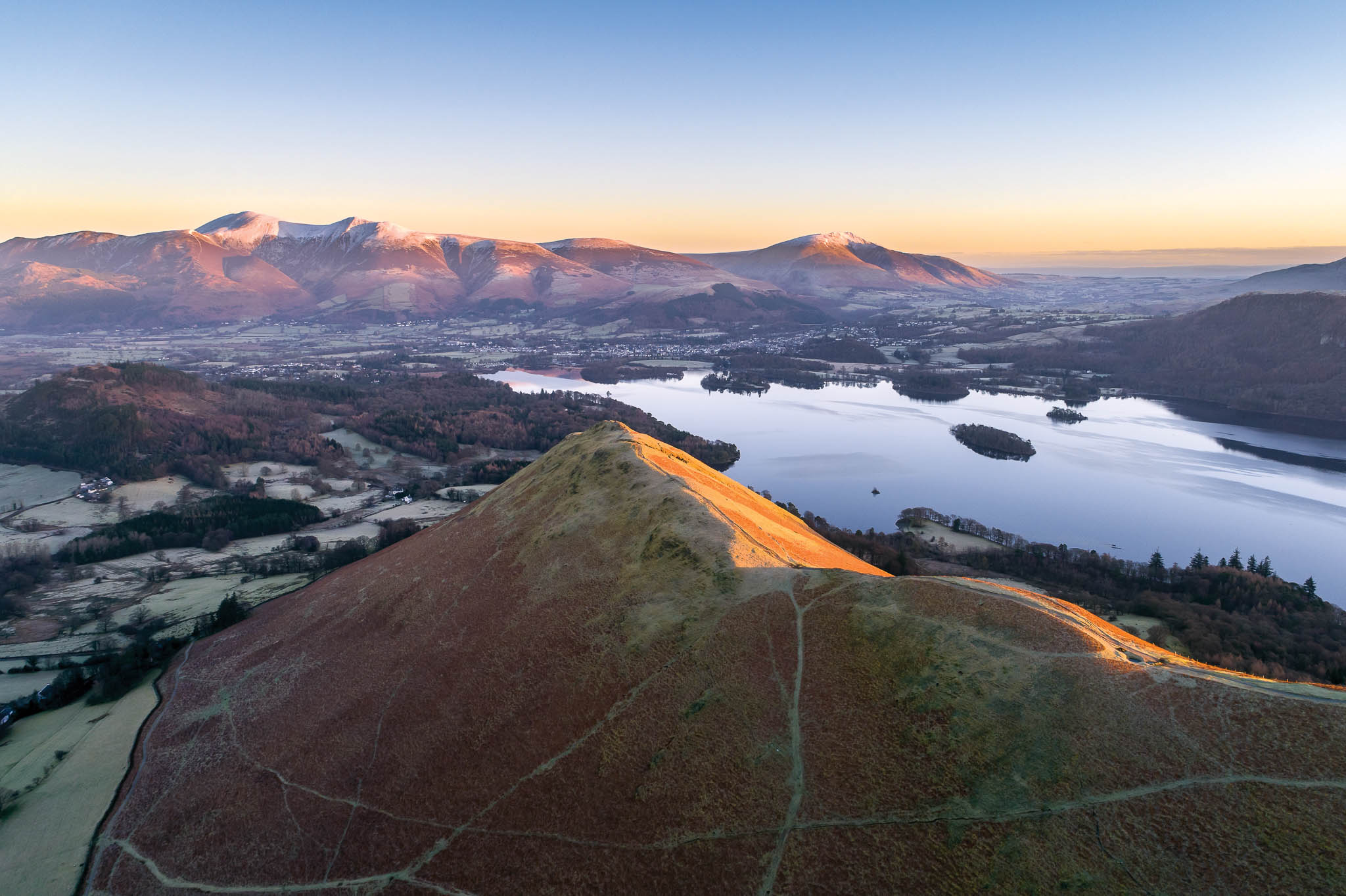 Catbells Dawn - This image was taken during the first days of the new year, our ascent of Catbells began in the dark around 5am, there's nothing better than seeing a new day come to life from atop a deserted mountain.Here you can see Blencathra bathing in the first sunlight of the day.