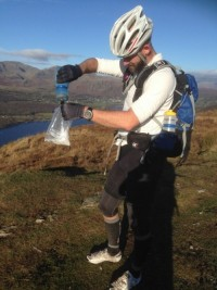 Anthony mixing his homemade energy pack with water he collected from a stream during the MTB