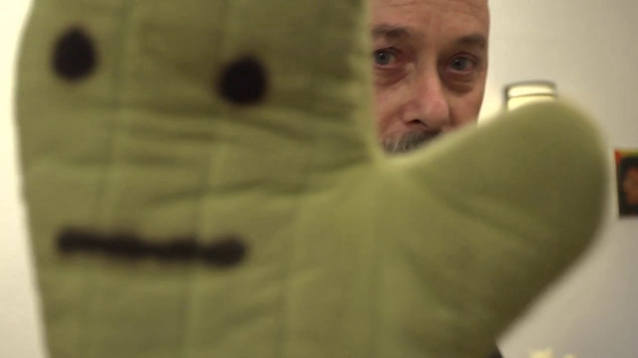 Zelevansky with a puppet, from Paul Zelevansky, Master Visual Artist 2013. Courtesy of Pittsburgh Center for the Arts.
