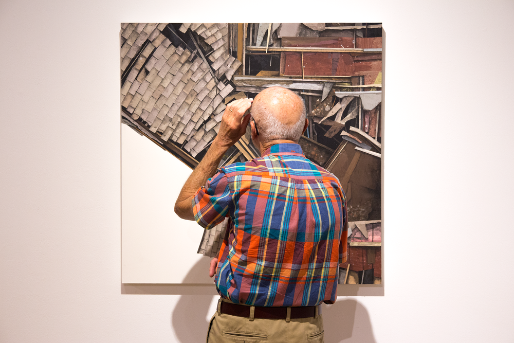 A visitor looks at Clark's  2015 Emerging Artist of the Year  exhibit at Pittsburgh Center for the Arts. Courtesy of Seth Clark.
