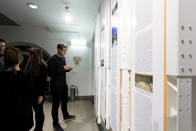 """A scrolling, """"print-out-the-internet"""" apparatus displays the  Avery Review  in Columbia's Avery Hall alongside new releases from GSAPP Books, October 23, 2015. The display was powered by motors calibrated to move at the pace of the editors' reading. Courtesy Columbia GSAPP."""