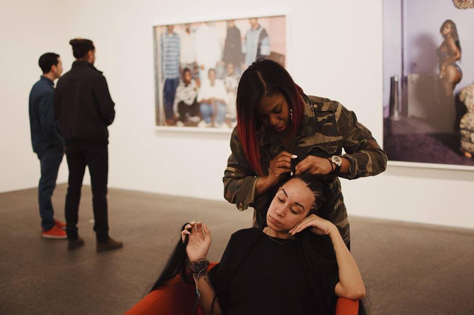 Flow State  performed by Shaquille Douglas and Tara Fay (sitting) in the Deana's Lawson solo exhibition exhibition at the CMoA. Courtesy Sarah Huny Young.