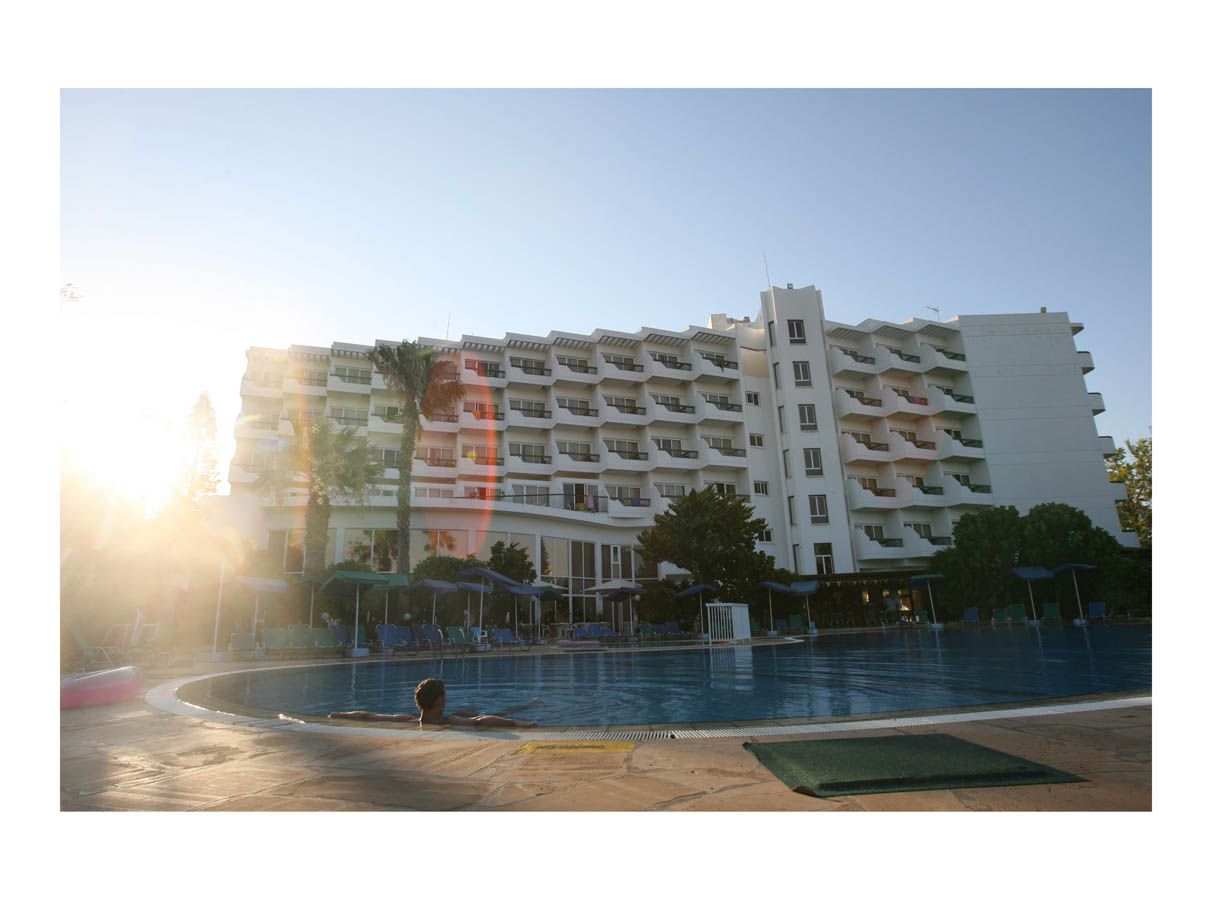 Hotel Pool  (Paralimni, Cyprus, 2008) by Johnny Green (53 x 73cm)  Price: £450   Size:20.9 H x 28.7 W x 1.2 in   This is the 1st of 12 Limited Edition C-type Lambda prints, encased in a beautiful gloss white ayous wood frame. The matt photograph is signed & dated en verso by the artist and has an elegant off white mount also.