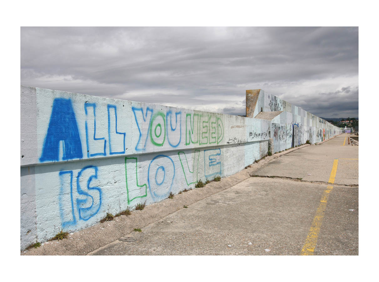 All You Need Is Love  (Baiona, Spain, 2009) by Johnny Green (53 x 73cm)  Price: £450   Size: 20.9 H x 28.7 W x 1.7 in   This is the 4th of 21 Limited Edition C-type Lambda prints, encased in a beautiful, black wooden frame. The matt photograph has an elegant off white mount which is signed and numbered by the artist.