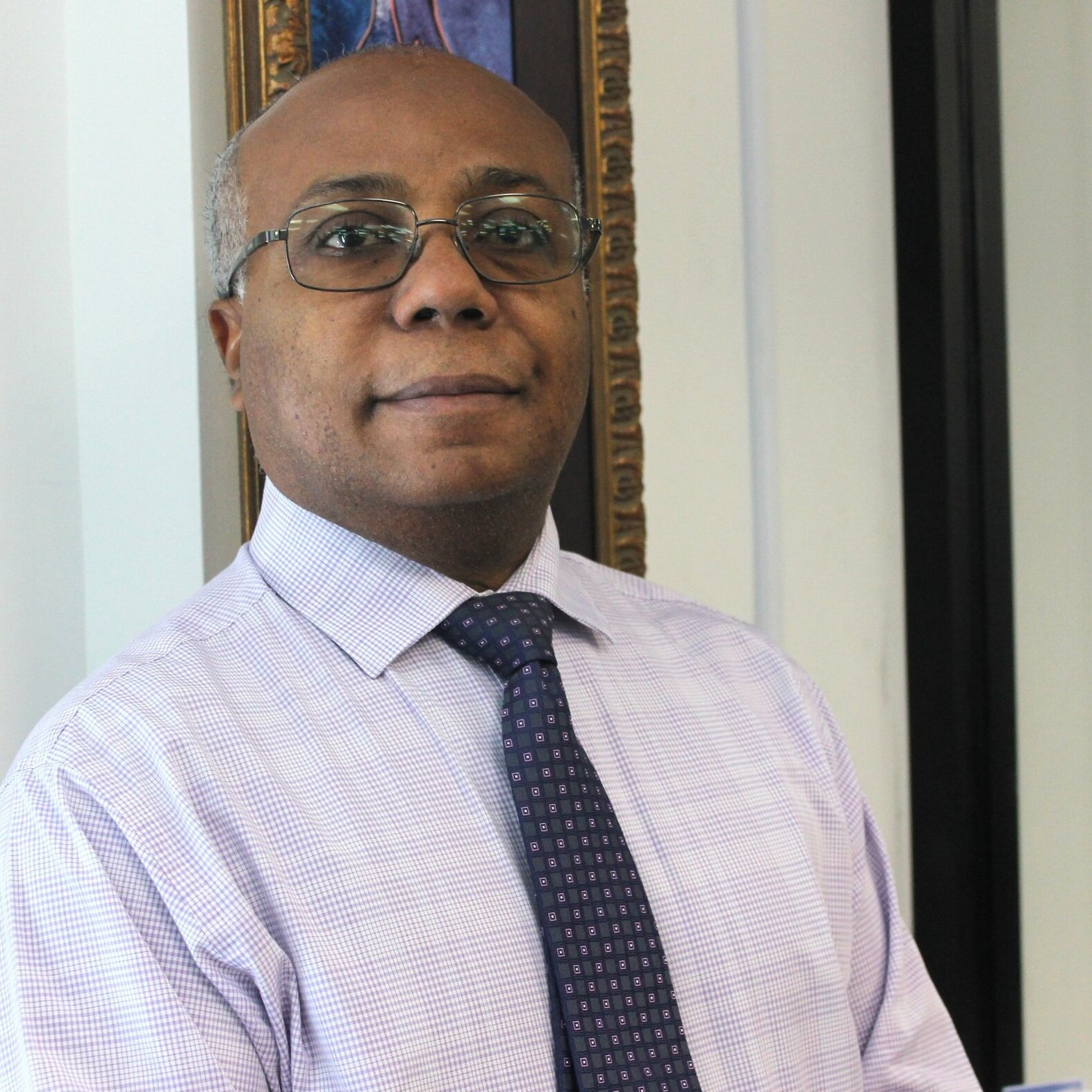Alphonse Piard,  Director of Financial & Literacy Services
