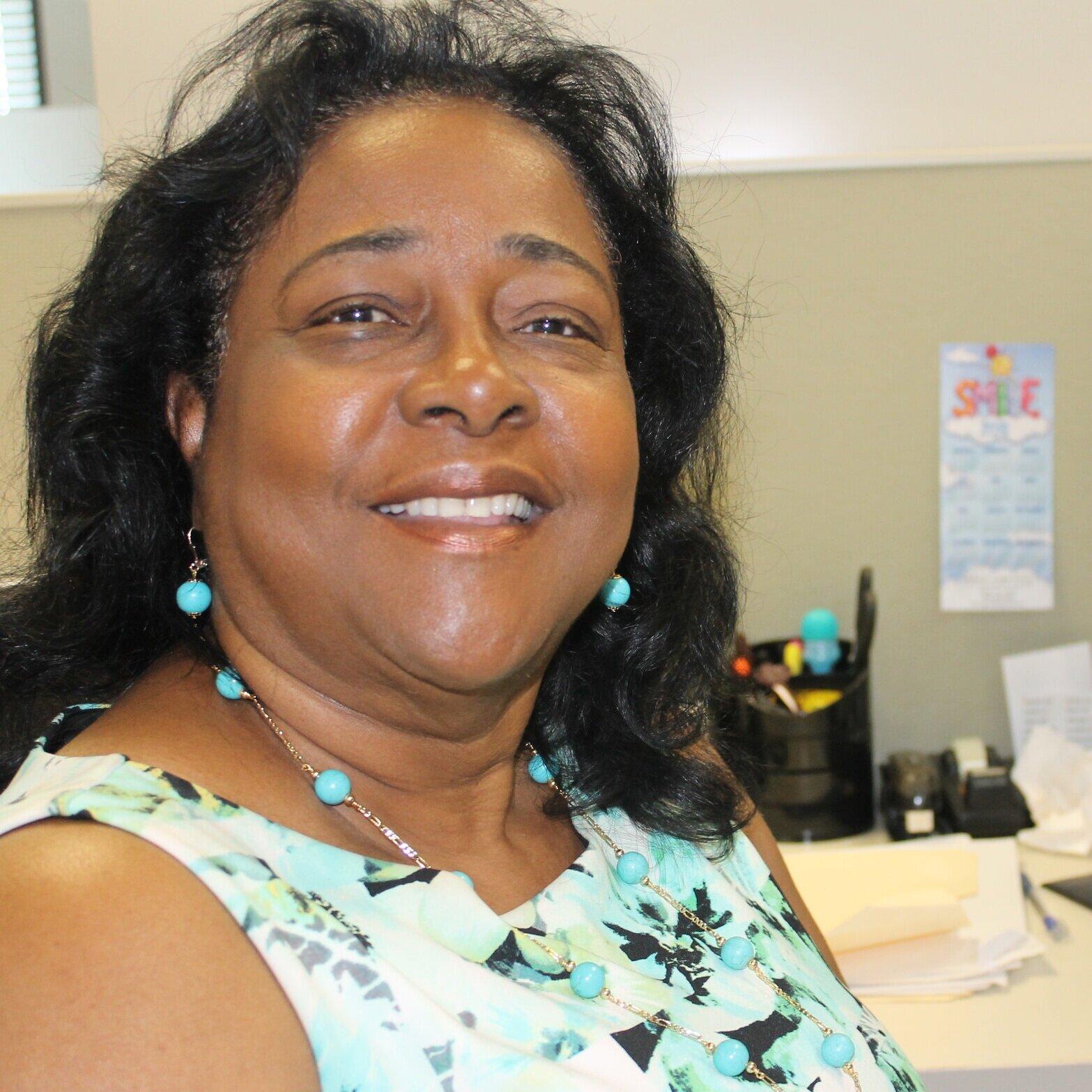 Junie Dareus,  Program Support