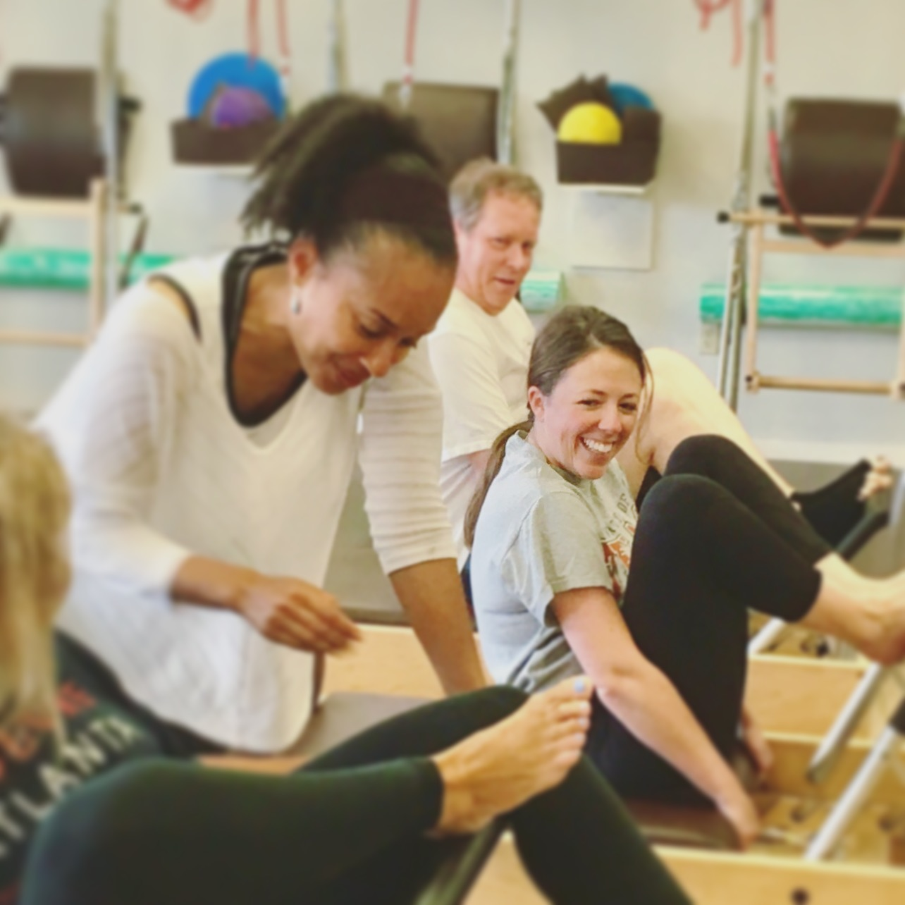 Smiling Pilates semi-private client with expert CORE Buckhead instructor Kimberly