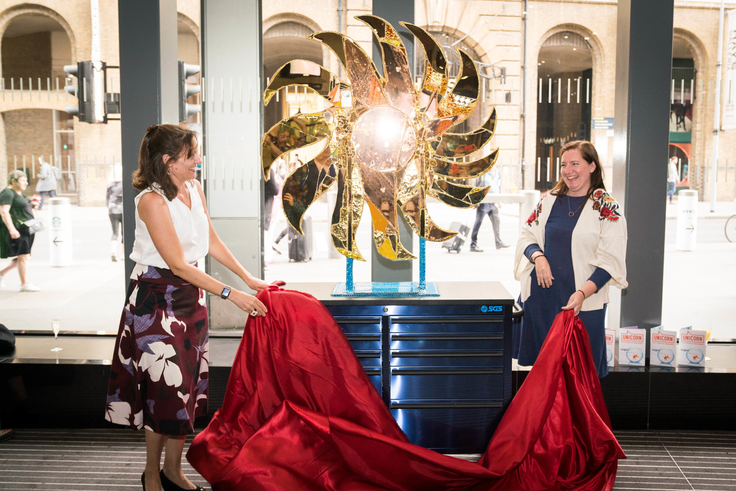 Nadia Broccardo (Team London Bridge) and Tamsie Thomson (London Festival of Architecture) unveil Sunshine! by Andrew Logan