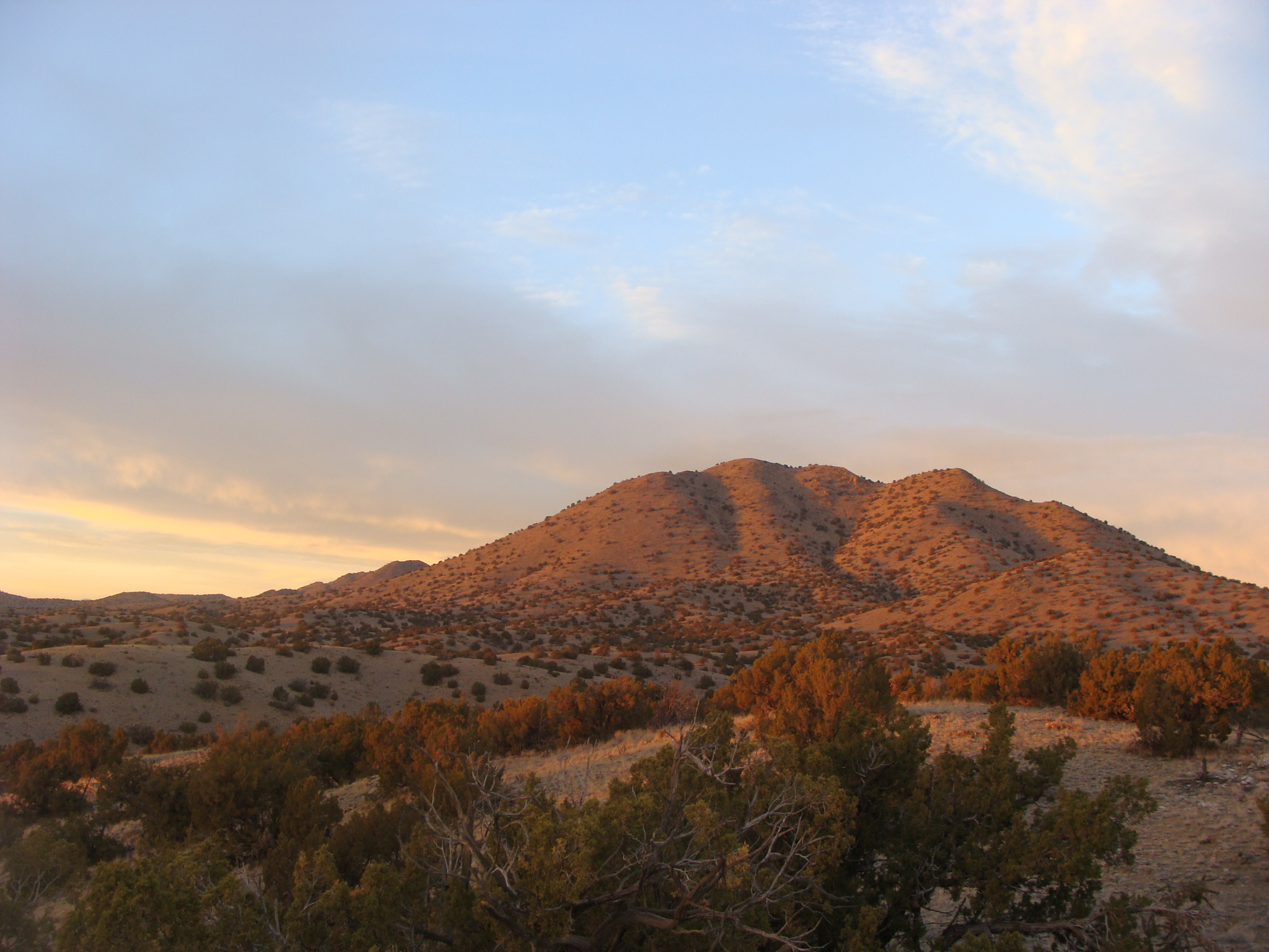 Hillsides bathed in evening light in cerrillos state park