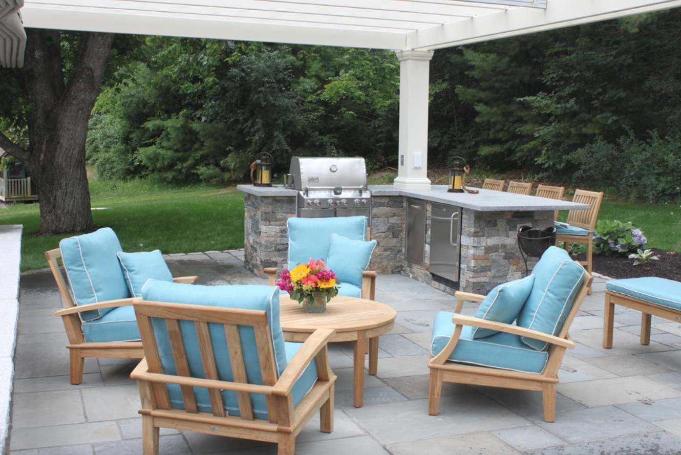 Outdoor masonry fireplace on a patio in Hollis, NH
