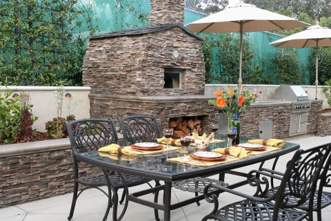 How to Enjoy Cooking in Your Outdoor Kitchen in All Weather Conditions in Waltham, MA