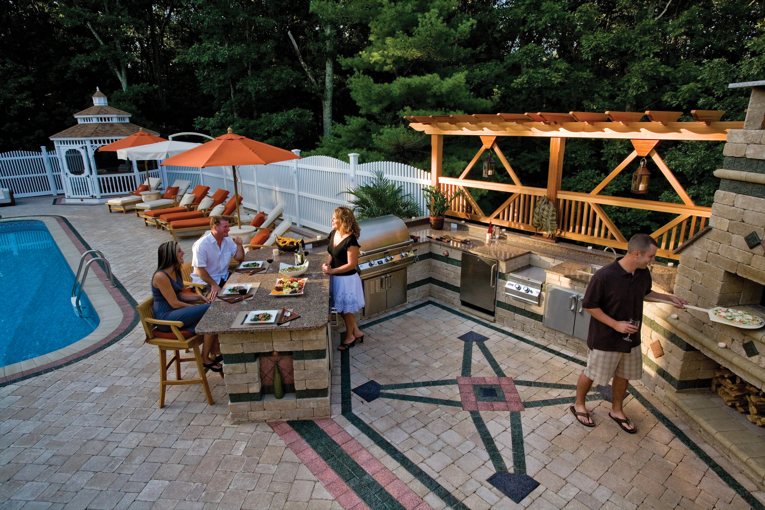 Maximize Your Poolside Experience This Summer with an Outdoor Kitchen Featuring a Refrigerator and Ice Maker and Other Must-Haves in Milford MA
