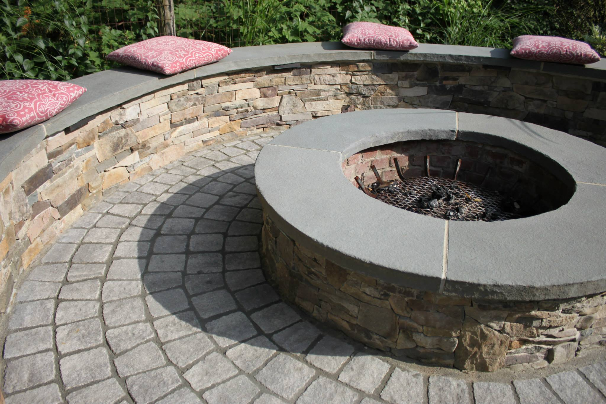 Perk Up your Concord, NH, Landscape Design with a Beautiful Fire Pit and Seating Wall