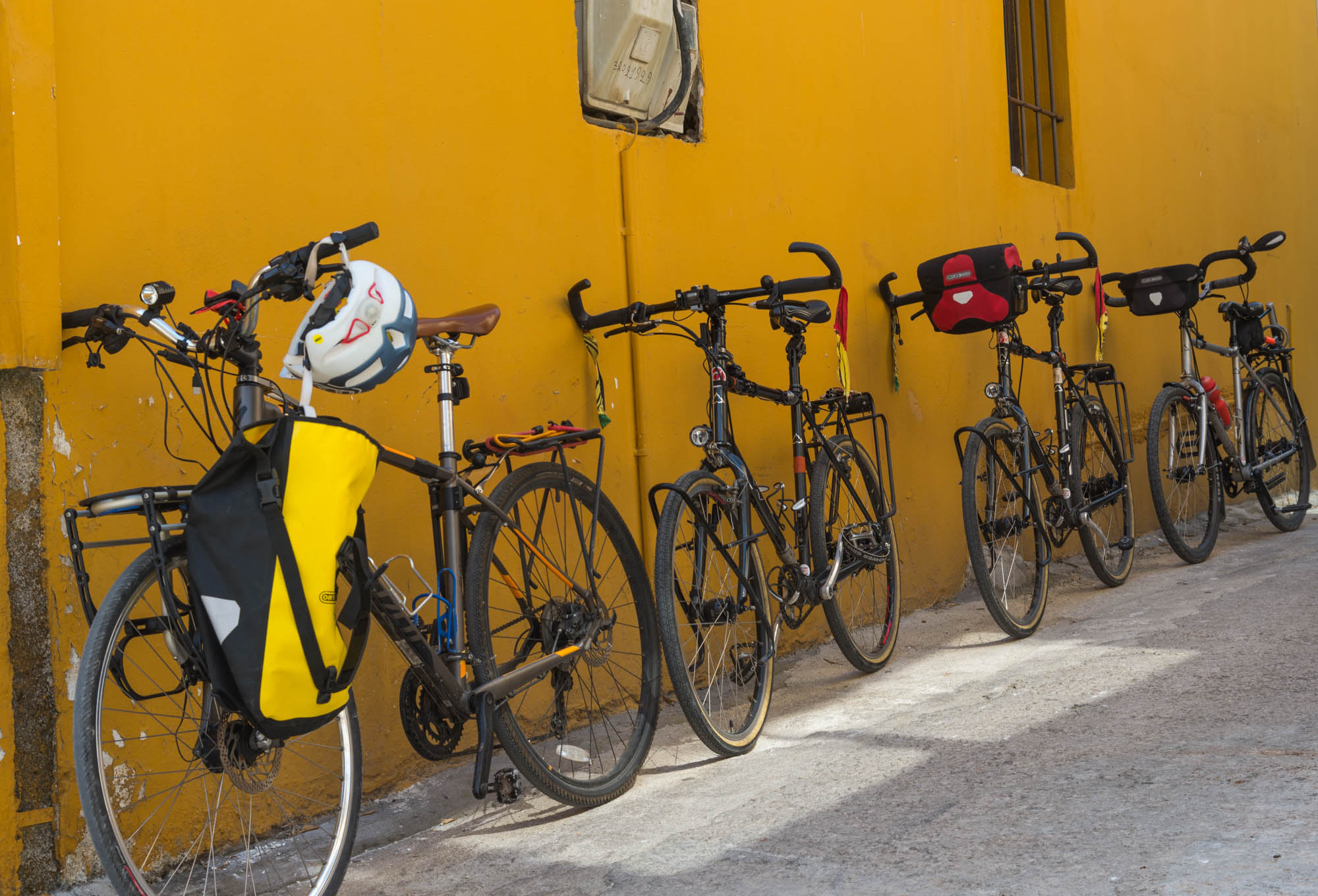 Four touring bikes - all outfitted with SteerStoppers® and parked on a downhill slope... no problem!
