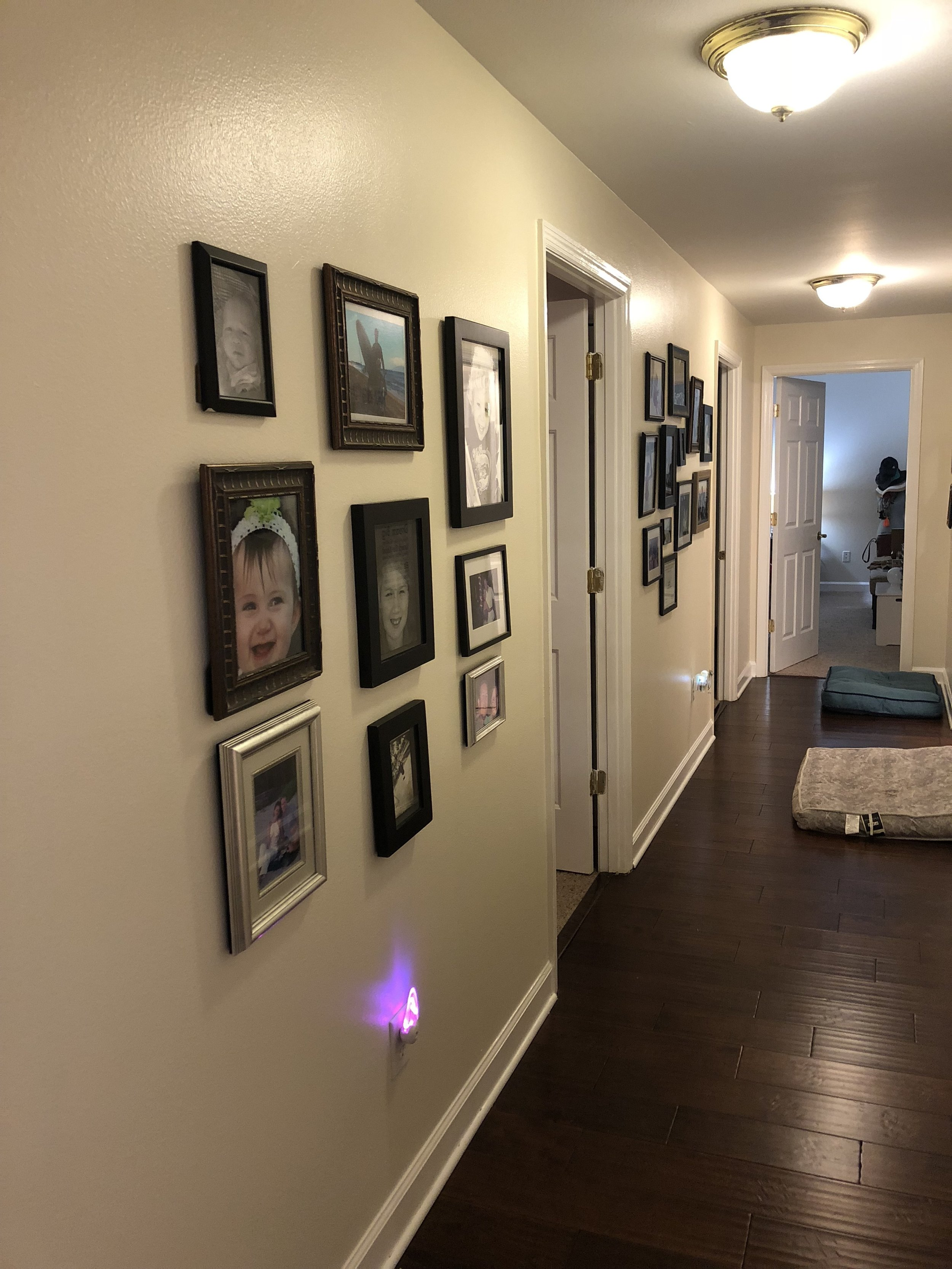 My kids insisted I put our family pictures up right away :)