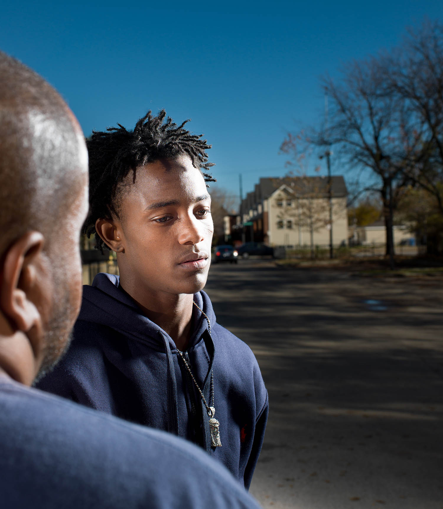 Student Jeryon Stevens outside Orr Academy with Cure Violence program coordinator Joshua Brooks.