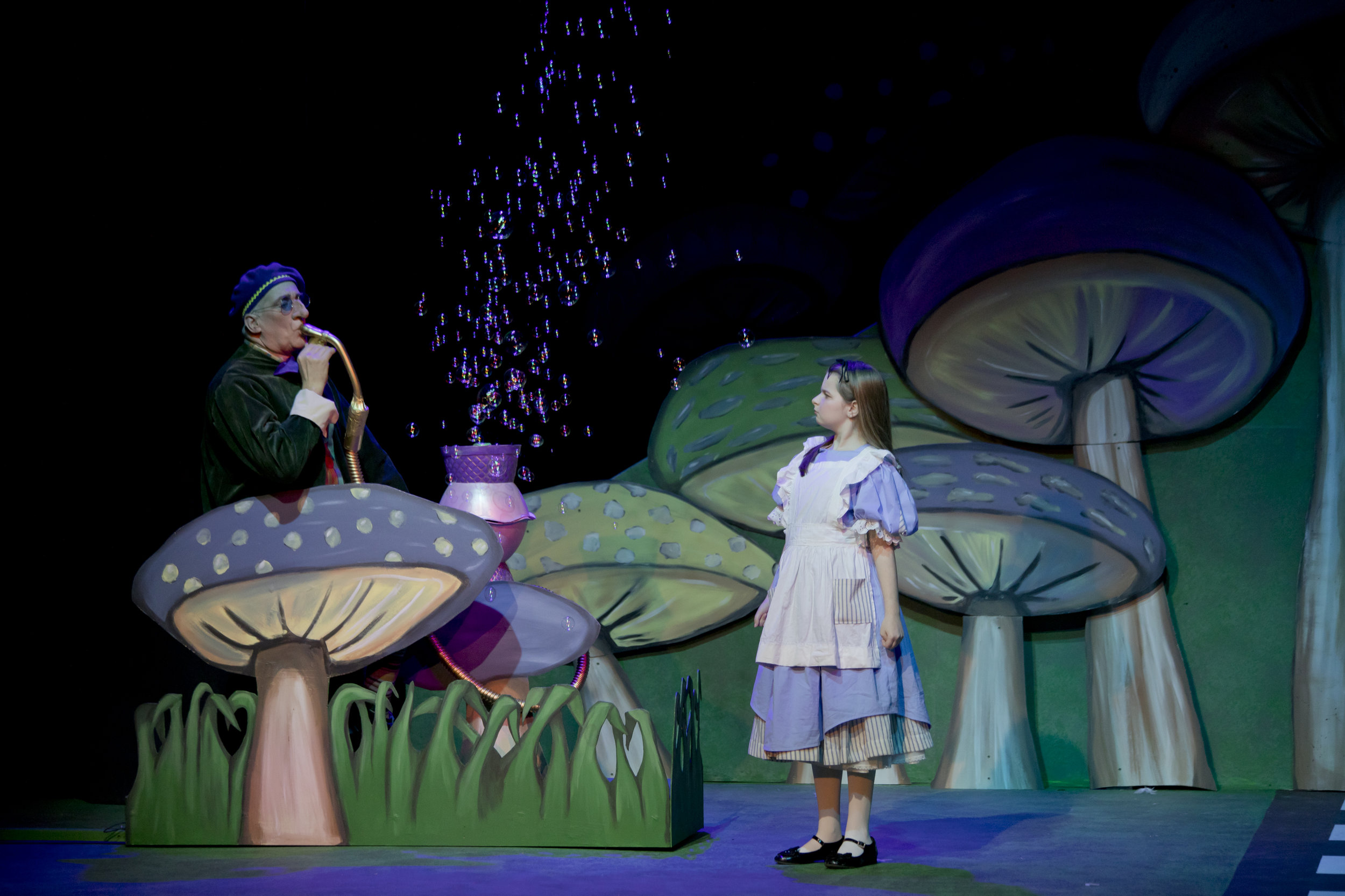 John Hall as the Caterpillar and Sadie Medlock as Alice in ACT's  Alice in Wonderland.