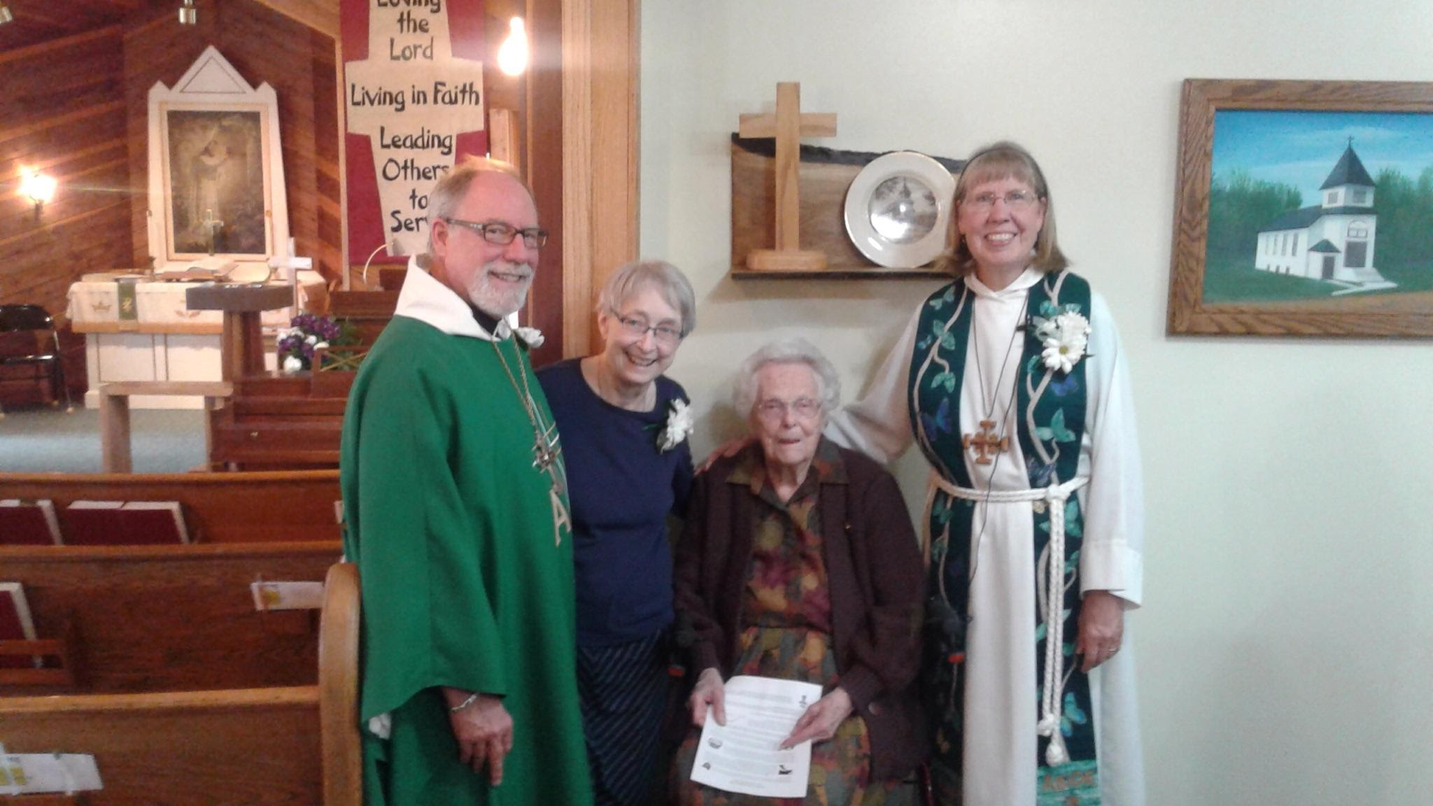 bishop with pastor sandy and members.jpg