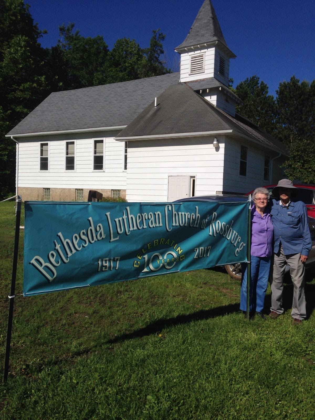centennial banner with Jack and Elaine Hallbeck.jpg