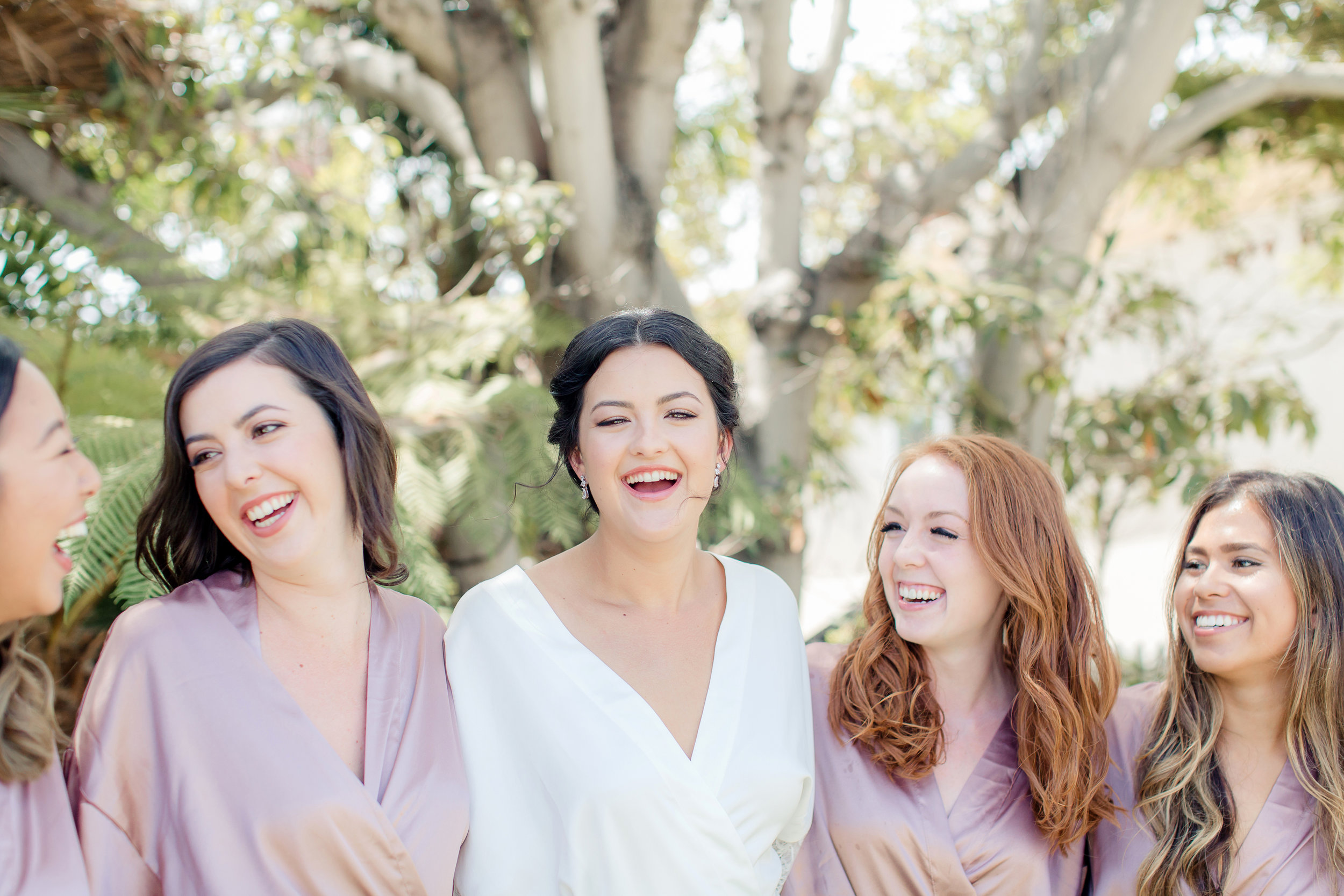 Happy bridal party, hair and makeup ready before the ceremony!