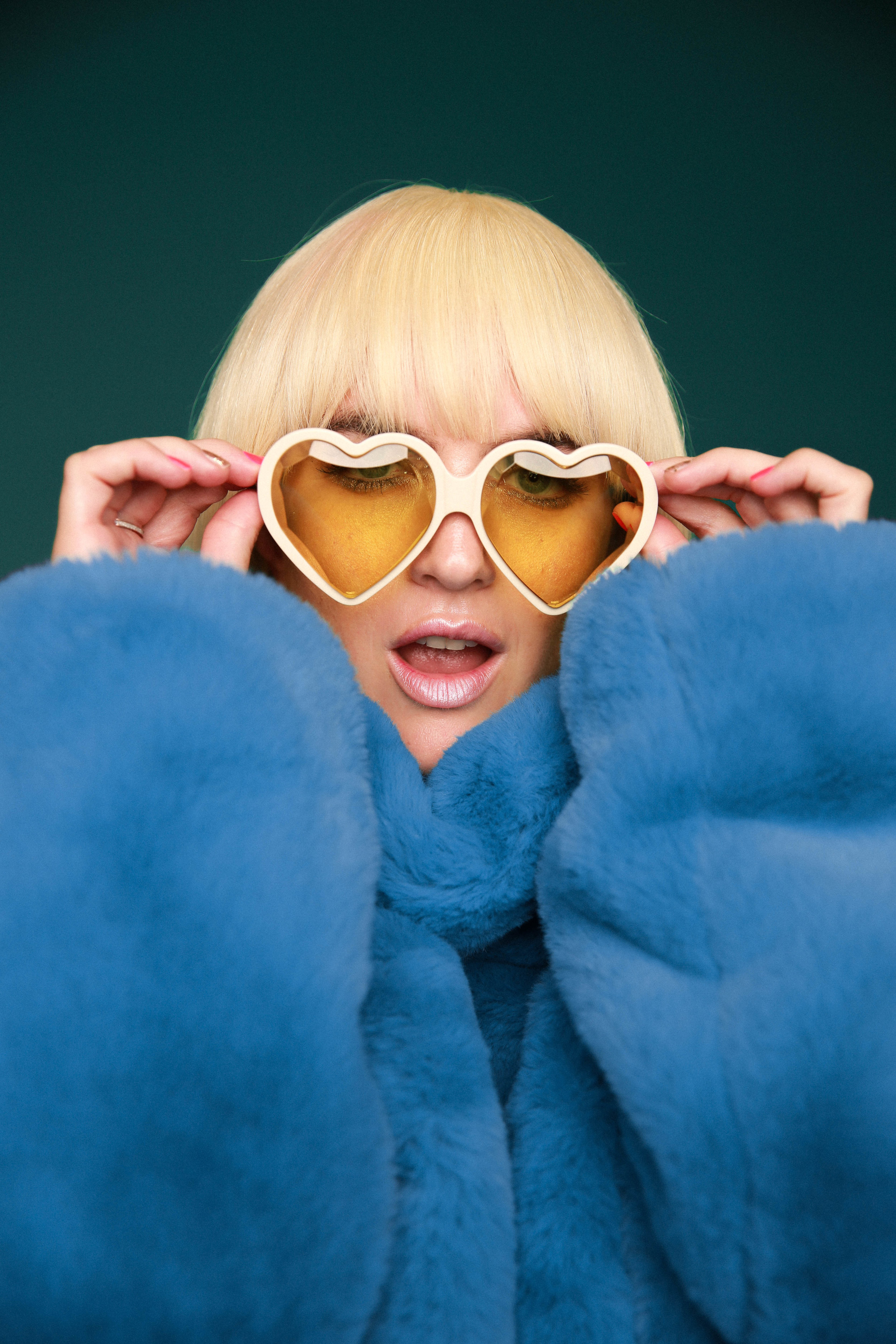Gucci sunglasses featured in press shoot for Gigi Rowe