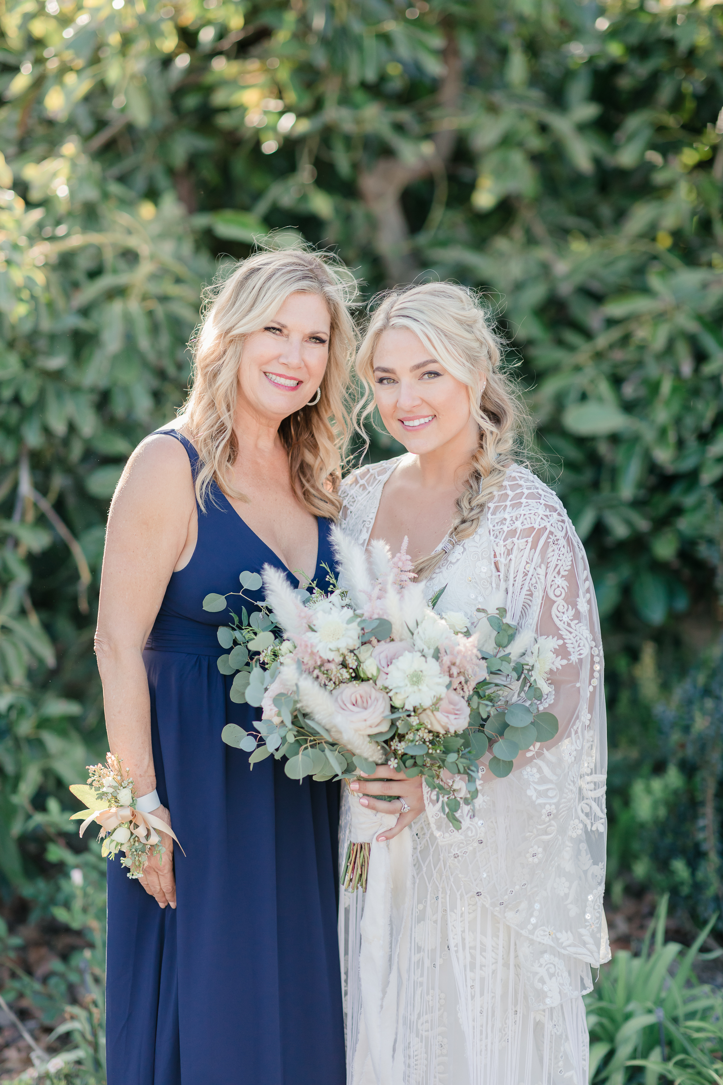 Mother of the bride and bride before their ranch wedding