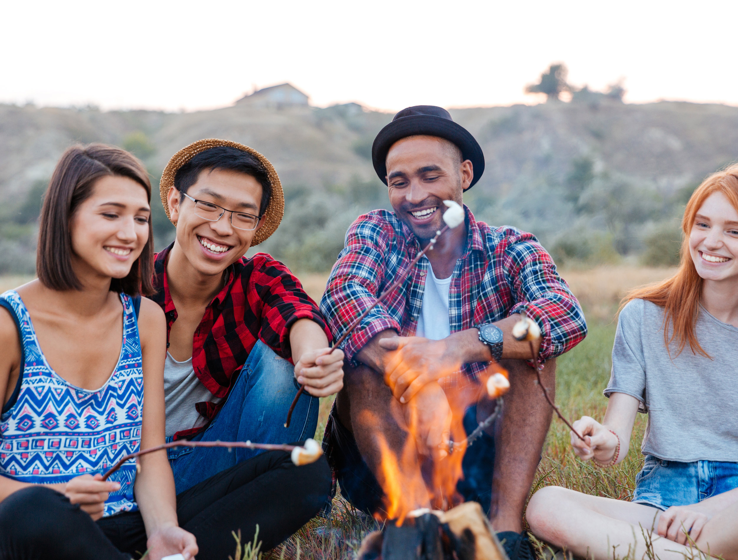 Toasting Marshmallows around a campfire